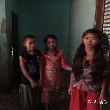 Girls standing in room