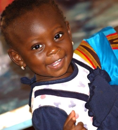 Little girl with a BiiBop doll in Burkina Faso